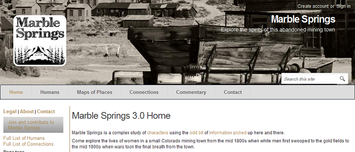 "Screen capture of ""Marble Springs 3.0"" by Deena Larsen (part 2 of 4). A black and white photograph of an abandoned mining town. Text: ""Marble Springs 3.0 Home / Marble Springs is a complex study of characters using the odd bit of information picked up here and there. Come explore the lives of women in a small Colorado mining town from the mid 1800s when white men first swooped to the gold fields to the mid 1900s when wars took the final breath from the town."""