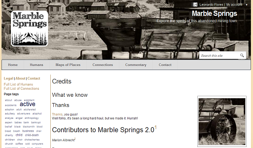 "Screen capture of ""Marble Springs"" NOT by Deena Larsen (part 4 of 4). The Marble Springs website is once again displayed with the photograph of the old mining town at the top. Text: ""Credits / What we know / Thanks / Thanks, you guys! Well folks, it's been a long hard haul, but we made it. Hurrah! / Contributors to Marble Springs 2.0 / (list of names too small to read)"""